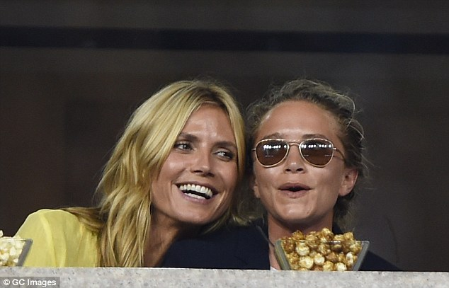 So friendly: Heidi got a chance to say hello to Mary-Kate Olsen who was at the match with her fiancé Olivier Sarkozy