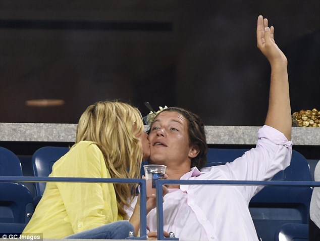 Can I watch the game now: Vito submitted to Heidi's amorous advances while keeping an eye on the game
