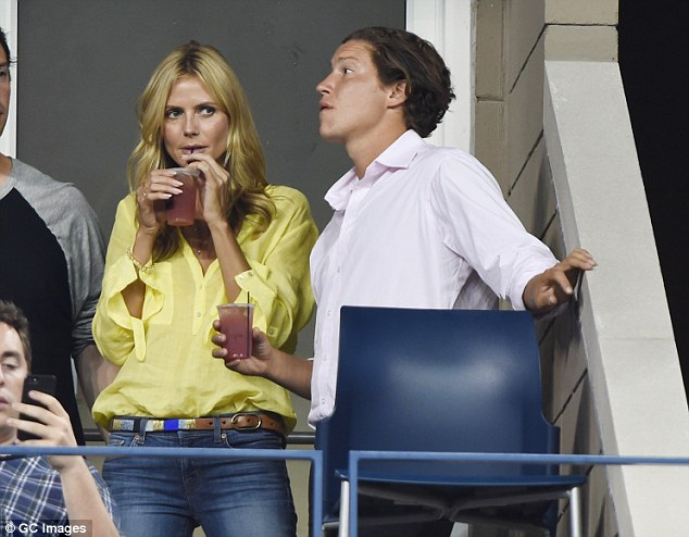 Contemplative sip: The supermodel sipped her cool drink thoughtfully while giving Vito the eye