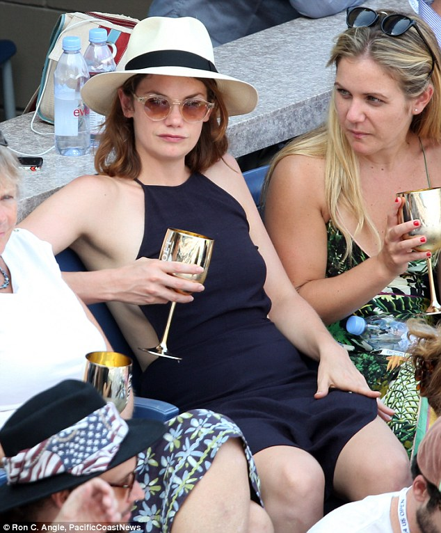 Golden goblet: The English actress sipped a drink from a very festive golden cup