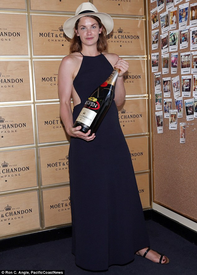 That's the spirit: Ruth Wilson posed with a magnum of Moet & Chandon champagne at the U.S. Open tennis event