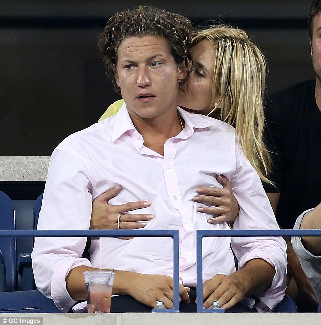 Snuggle time: Heidi couldn't keep her hands off her man as they cuddled up together in the stands