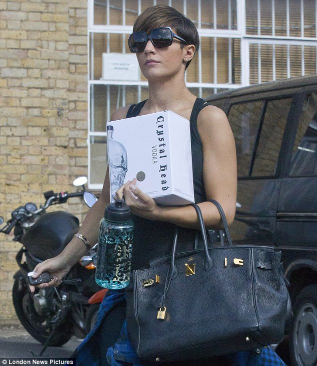 That should loosen you up for dancing: Frankie Sandford arrived at dance rehearsals for The Saturdays' new tour carrying a box of Crystal Head vodka on Sunday