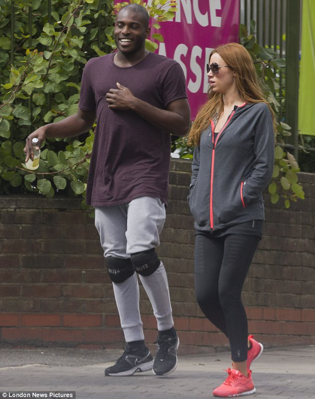 Yummy mummy: Una Healy looked fit and toned as she chatted to a dancer on a break from rehearsals