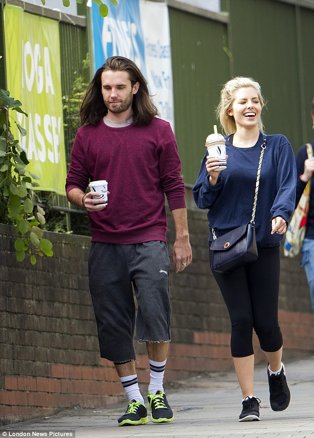 Giggling away! The blonde beauty was in great spirits as she grabbed a refreshment between rehearsals