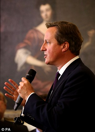Disgusting and despicable: Prime Minister David Cameron addresses members of the Nato Parliamentary Assembly during a reception at 10 Downing Street in central London before rushing back to 10 Downing Street on being informed of the execution of American journalist, Steven Sotloff