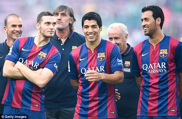 All smiles: Luis Suarez (centre) is unveiled at the Nou Camp this week