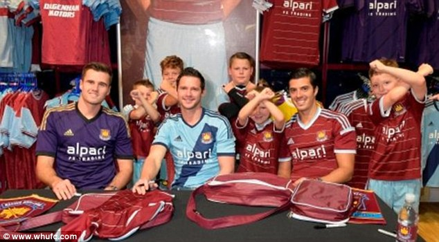 Day out: Jenkinson (left), Matt Jarvis (centre) and James Tomkins (right) met fans in Lakeside