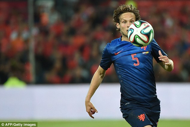 On the ball: Blind shone for Holland as they finished third at the 2014 World Cup in Brazil