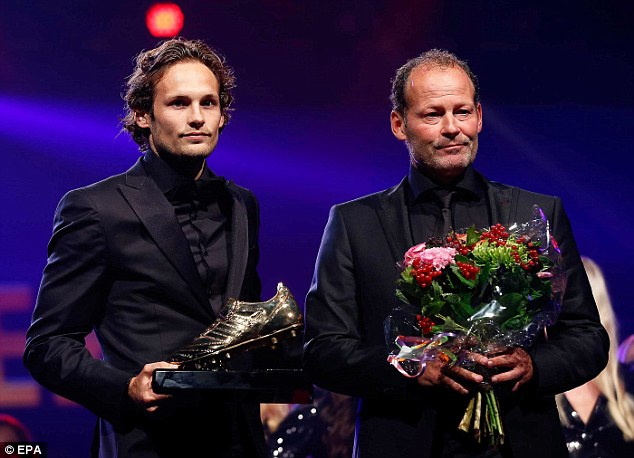 Proud moment: Blind (left) was voted the 2014 Dutch Footballer of the Year, next to his father