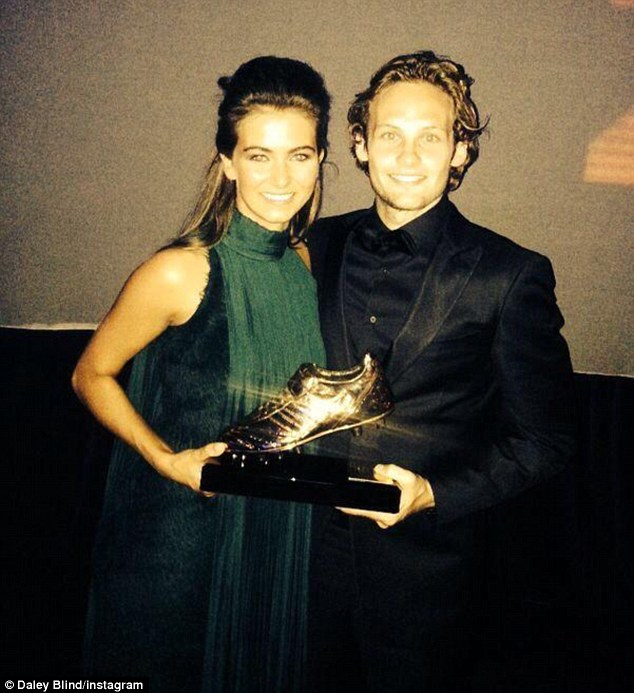 Golden couple: Blind's girlfriendCandy-Rae Fleur (left) was with him to collect his Footballer of the Year award