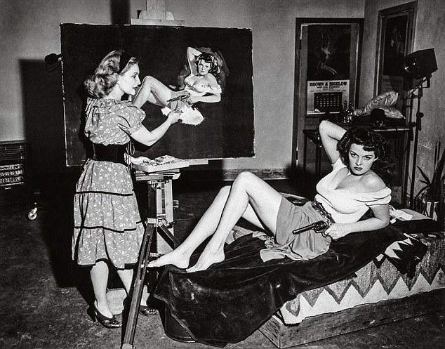A real scene of an artist at work creating the perfect pin-up likeness of her gun-toting model