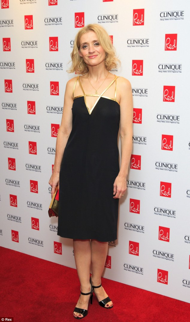 Chain reaction: Actress Anne-Marie Duff looked cute in a black dress with gold trim