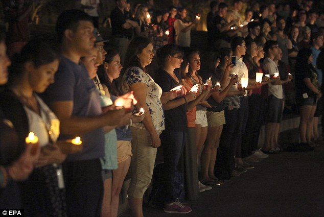 Hundreds of people attended the vigil organised bythe Society of Professional Journalists, UCF chapter