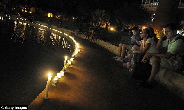 Candles are pictured in a ring around the Reflection Pool on the UCF campus where a vigil was held for Sotloff