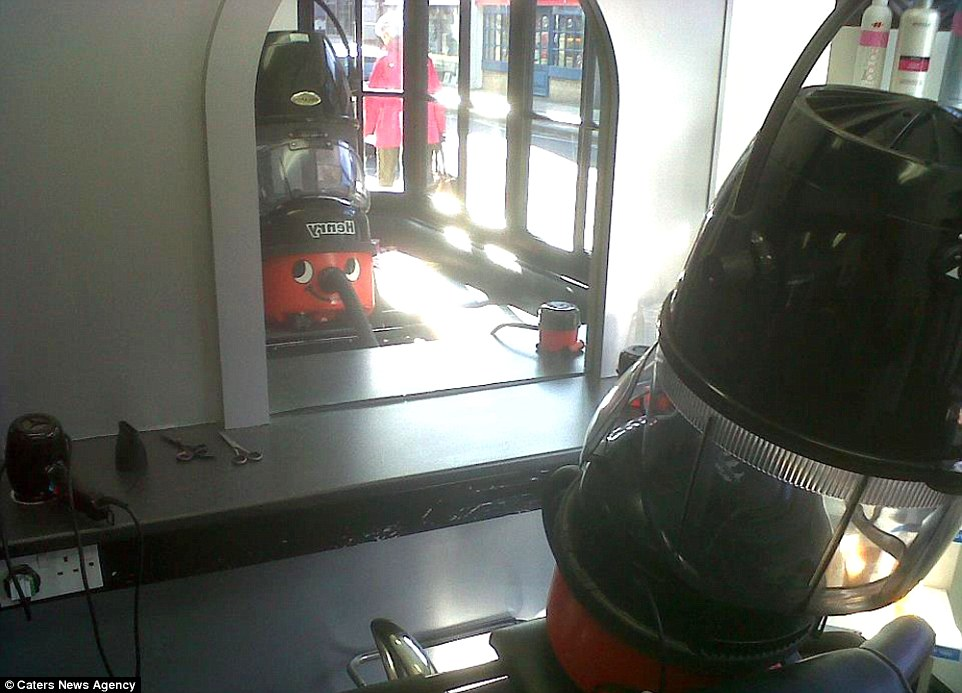 "At the hairdressers: Mr Walker said: 'While being bored while vacuuming, I thought ""everyone loves Henry Hoover!"", so I decided to take him on little adventures'"
