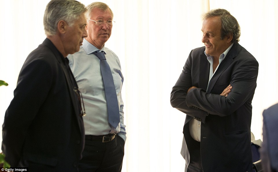 Talking a good game: UEFA president Michel Platini has a convesation with Ancelotti and Ferguson on Thursday