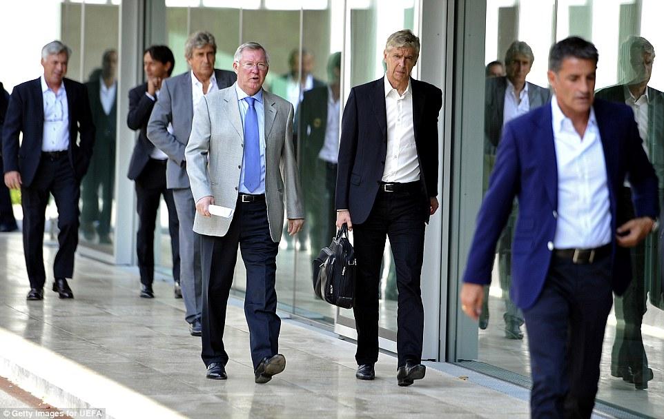 Old foes: Ferguson walks alongside Wenger with Manchester City boss Manuel Pellegrini strolling just behind
