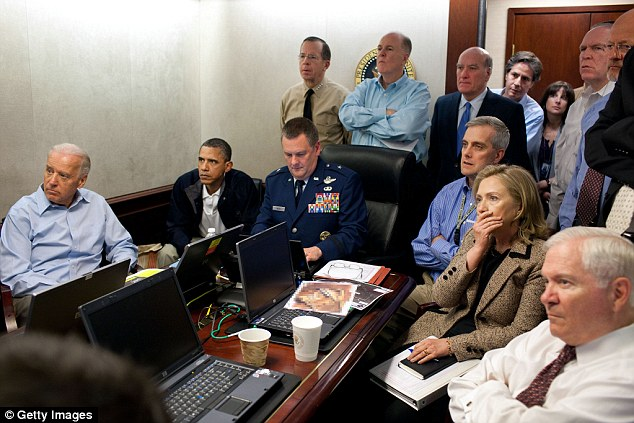 Hearts in mouth: President Obama, with Secretary of State Hilary Clinton and vice president Joe Biden, watched the raid unfold in front of their eyes back in Washington D.C.