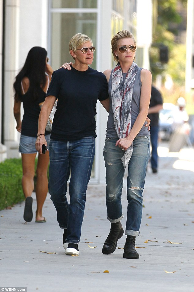 Casual couple: While both women chose laidback boyfriend jeans, Portia completed her cool biker image with black boots and Ellen went slick in skater slip-ons