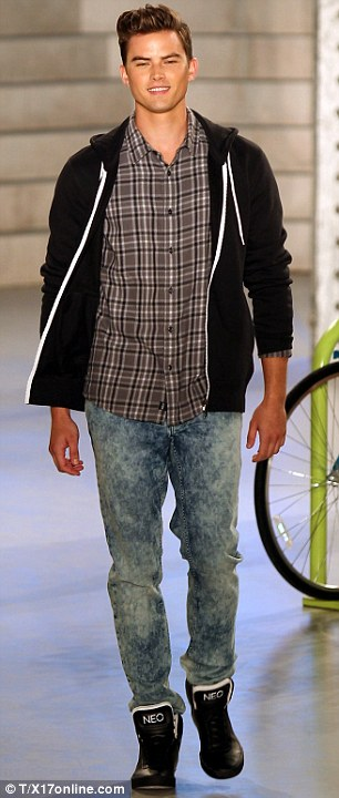 Sporty chic: Graphic print T-shirts and jeans for girls were seen and plaid shirts and jackets for guys