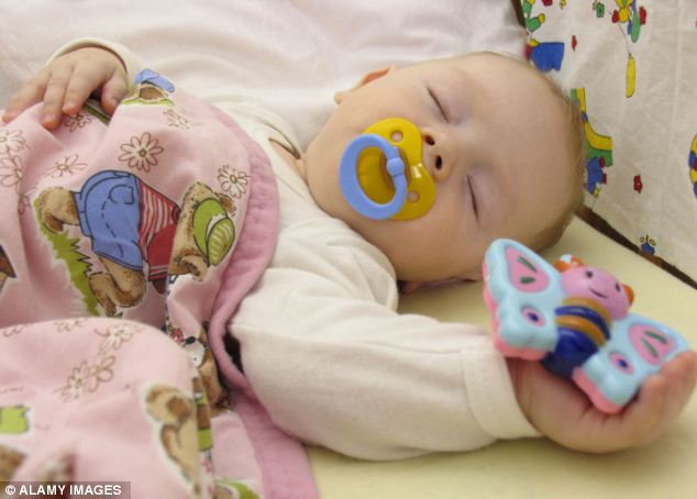The findings raise the possibility that parents using dummies to calm a crying infant could harm the parent-child bonding process by obscuring the baby's face. (File picture)
