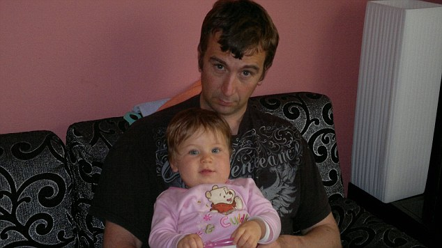 A witness to the kidnapping of Mr Haines - pictured with his younger daugther - has told how 'professional' gunmen seized him in northern Syria last year