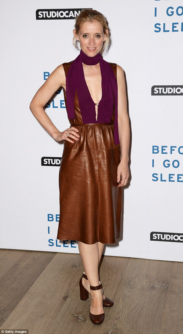 Pose for cameras:Anne-Marie Duff turns heads in a plunging leather dress at the screening of Before I Go To Sleep in London on Thursday evening