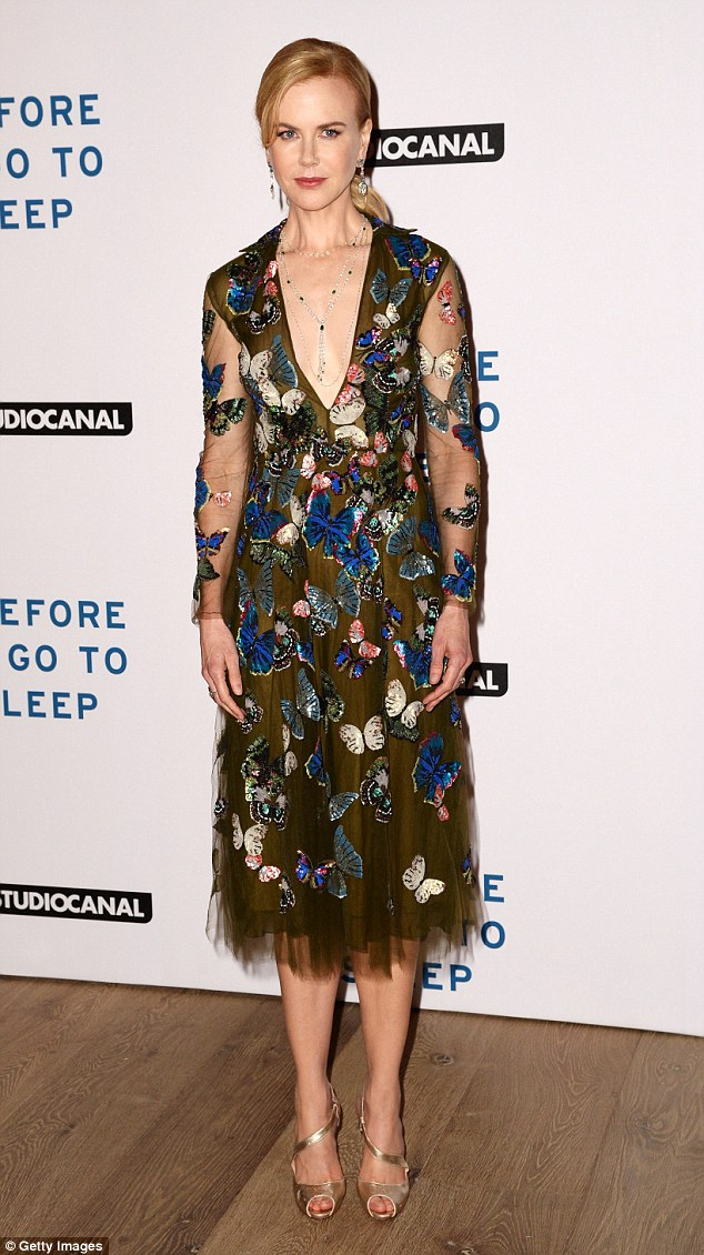Leading lady: Nicole Kidman looked elegant in a long-sleeved gown which was adorned with colourful butterflies
