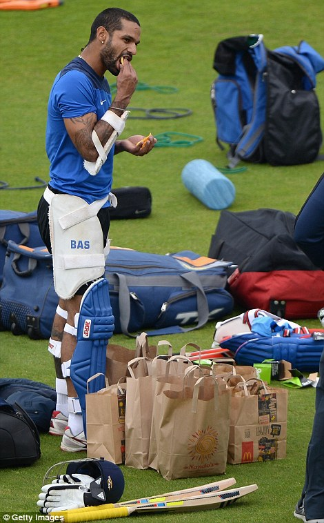 Chipping in: Shikhar Dhawan tucks into some fries