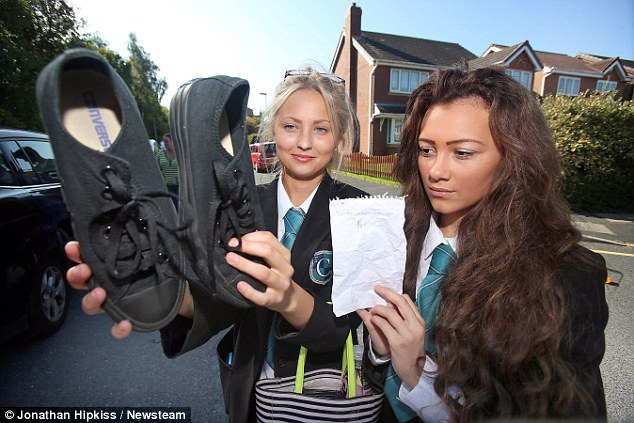 Told to toe the line: Around 100 pupils were still given the boot from lessons after their shoes were inspected by staff