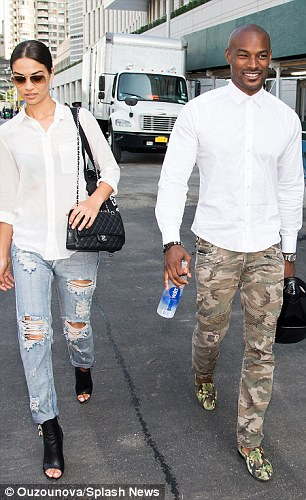 Matching outfits: The recently reunited pair both wore white shirts and jeans