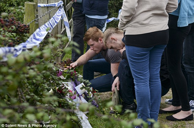 Members of Pennie Davis' family lay floral tributes near the scene where the mother-of-five was murdered