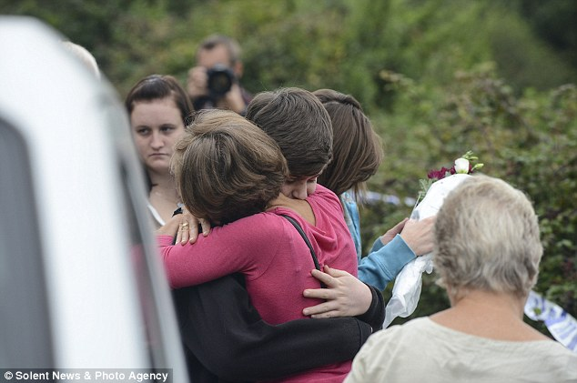 Friends and relatives held each other tightly as they tried to understand what had happened on Tuesday