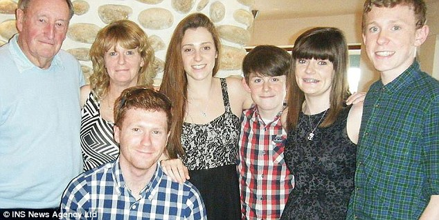 Grieving: Pennie Davis (second left), 47, with (left to right) Pennie's father (far left), and sons and daughter Alex, 19,  Georgia, 18,  Josef, 13, Sophie, 20 and Daniel, 15