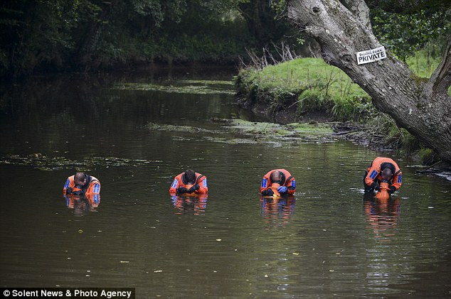 The officers searched in a straight line ensuring that every inch of the waterway was inspected