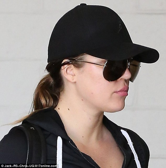 Undercover: The 30-year-old threw on a cap and a pair of large aviator sunglasses