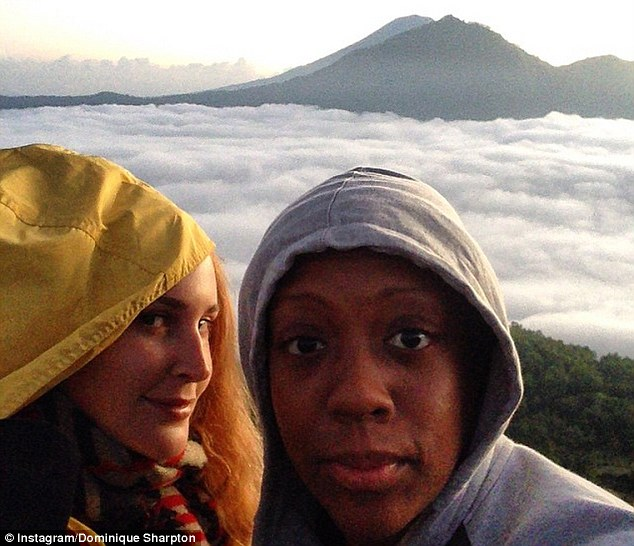 Ms Sharpton's suit over a sprained ankle was hurt when she posted photos of herself climbing a mountain in Bali last year (pictured)