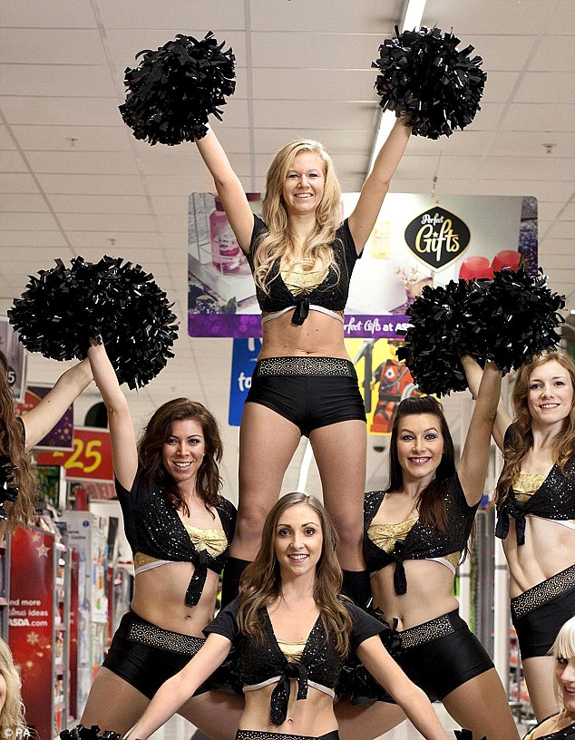Excitment: Cheerleaders at the Asda store in Wembley, north west London during last year's Black Friday