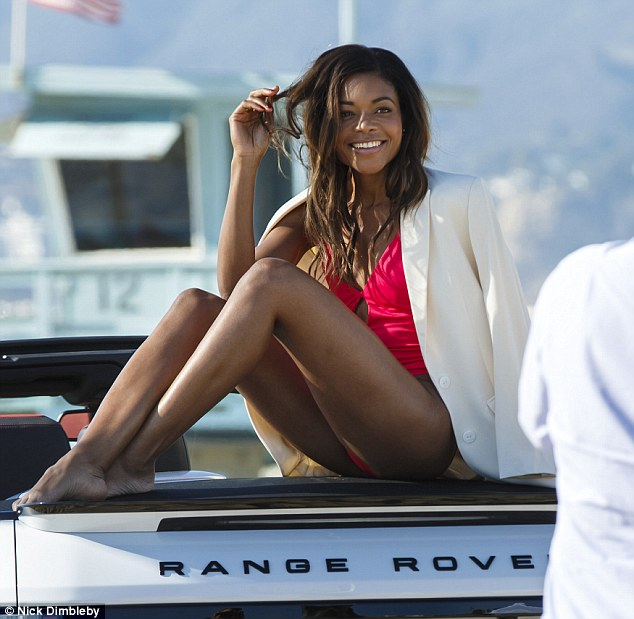 Naomie Harris shows off toned body in bright pink cut-out