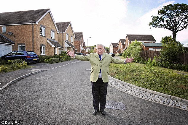 Fergus Wilson: The outspoken investor, pictured outside seven properties he owns, said one of his tips for buy-to-let was: 'buy where it doesn't flood'