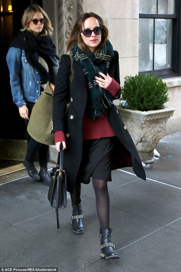 Dakota Johnson leaves NYC apartment moments after ...