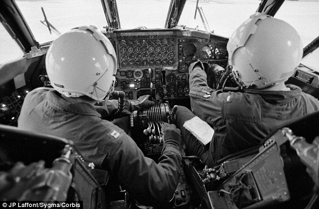 A pilot and co-pilot of a B-52 bomber in an image taken in 1972. These bombers are not out of date at the Air Force is looking to replace them with 100 B-21 bombers