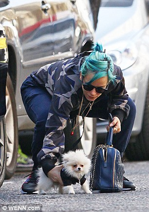 Lily allen sports star print hoody and navy tracksuit for Marnie oursler husband