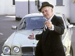 TELEVISION PROGRAMME: 'MINDER'..ACTOR, GEORGE COLE, AS  CAR SALESMAN ARTHUR DALEY, WITH  JAGUAR XJ6 MOTORCAR.......ARTHUR DALEY..CAR..CAR DEALER..TV SHOW..BARRY BRECKON