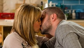 Pucker up: Aidan appears to make the first move, leaning in towards Maria he passionately kisses her on the lips