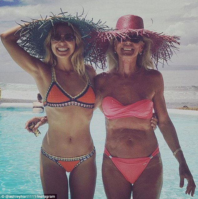 Who's the model here? As model Ashley (L) posed poolside in Bali on Tuesday standing next to her mother-in-law Inge Palmer (R), her fit figure was given a run for its money