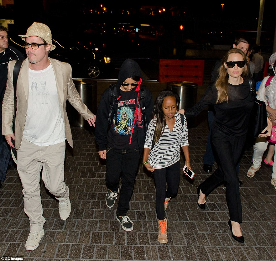 Ugly split? Angelina is requesting sole physical custody of their six children in her divorce papers, with visitation right for Brad. They are shown here in 2014 with Maddox and Zahara