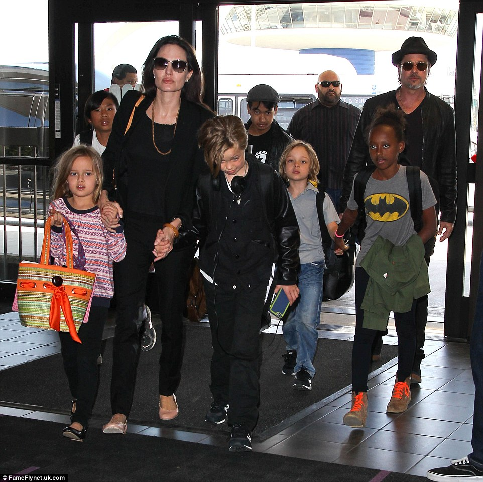 The gang's all here: Pitt and Jolie with their six children at LAX in June 2015 (above)