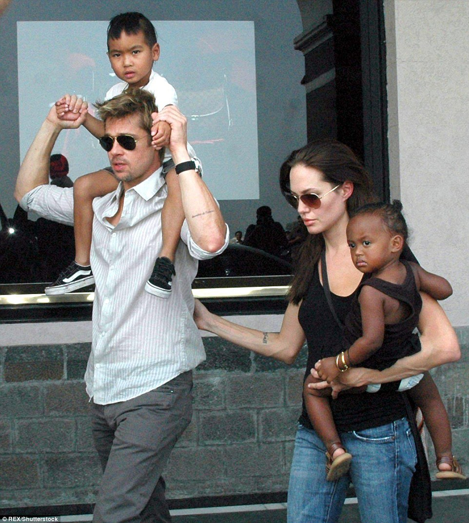 Daddy duty: Brad applied to adopt Maddox and Zahara in January 2006 (they are shown here in November of that year)